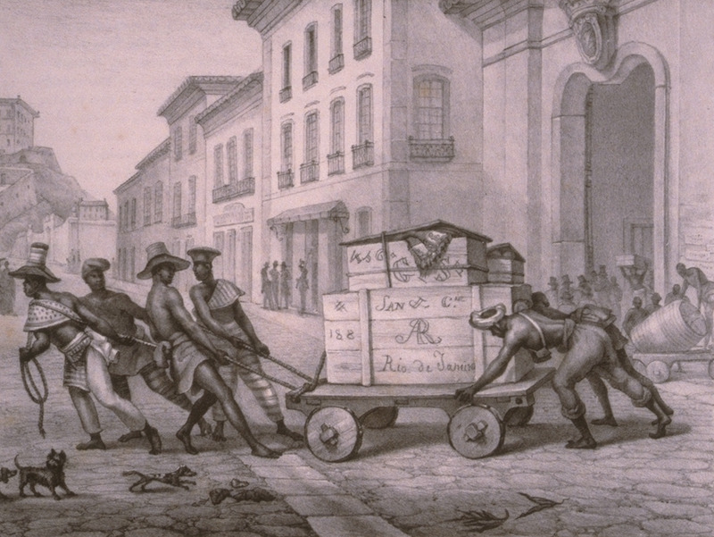 An urban scene, depicting slaves moving a loaded cart through the streets. The engravings in this book were taken from drawings made by Debret during his residence in Brazil from 1816 to 1831. For watercolors by Debret of scenes in Brazil, some of which were incorporated into his Voyage Pittoresque, see Jean Baptiste Debret, Viagem Pitoresca e Historica ao Brasil (Editora Itatiaia Limitada, Editora da Universidade de Sao Paulo, 1989; a reprint of the 1954 Paris edition, edited by R. De Castro Maya).