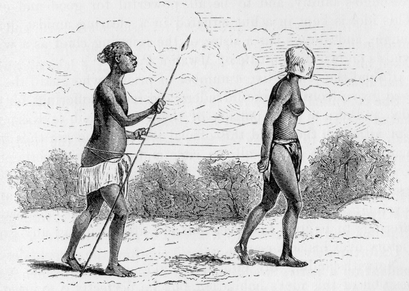 This sketch shows a captive African woman, with a mask over her head walking in front of a Warua male, with a spear. The image is not described in the text, but it appears the mask is attached to some sort of line which winds around the waist of the slave driver and then attaches to the wrist of the captive female. Based on observations made in November, 1874, among the Warua, a group in Tanganyika. Verney Lovett Cameron (1844–1894) was the first European to cross equatorial Africa from sea to sea. His travel memoirs contain valuable suggestions for the opening up of the continent from north to south, including using the great lakes as a Cape to Cairo connection.