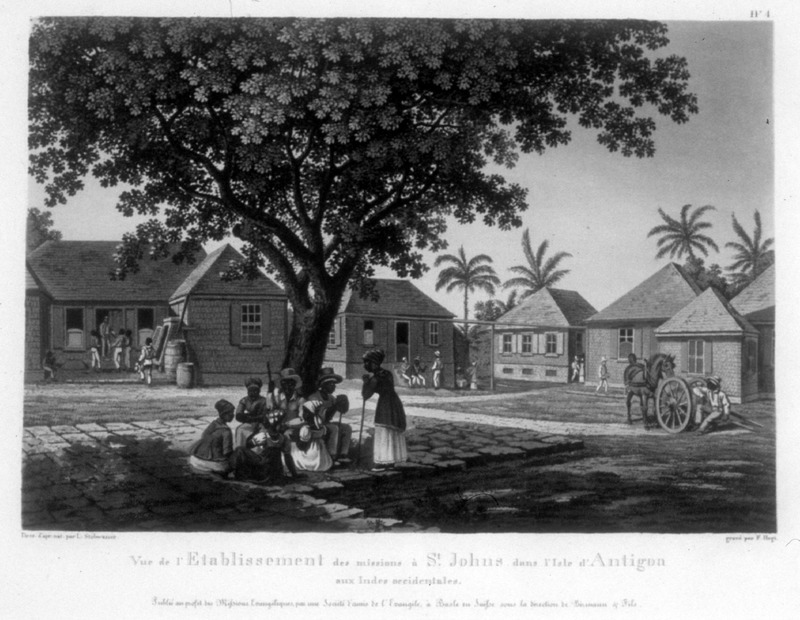 """View of the establishment of missions in St. John in the island of Antigua in the West Indies"" (caption translation). This image shows a Moravian mission station with buildings in the background and people in the foreground. One of a set of four separately published engravings, which were likely compiled by John Henry Lewis Stobwasser, probably the son of Johann Heinrich Stobwasser (1740-1829), who was a Moravian missionary in Antigua from 1812 until 1822."