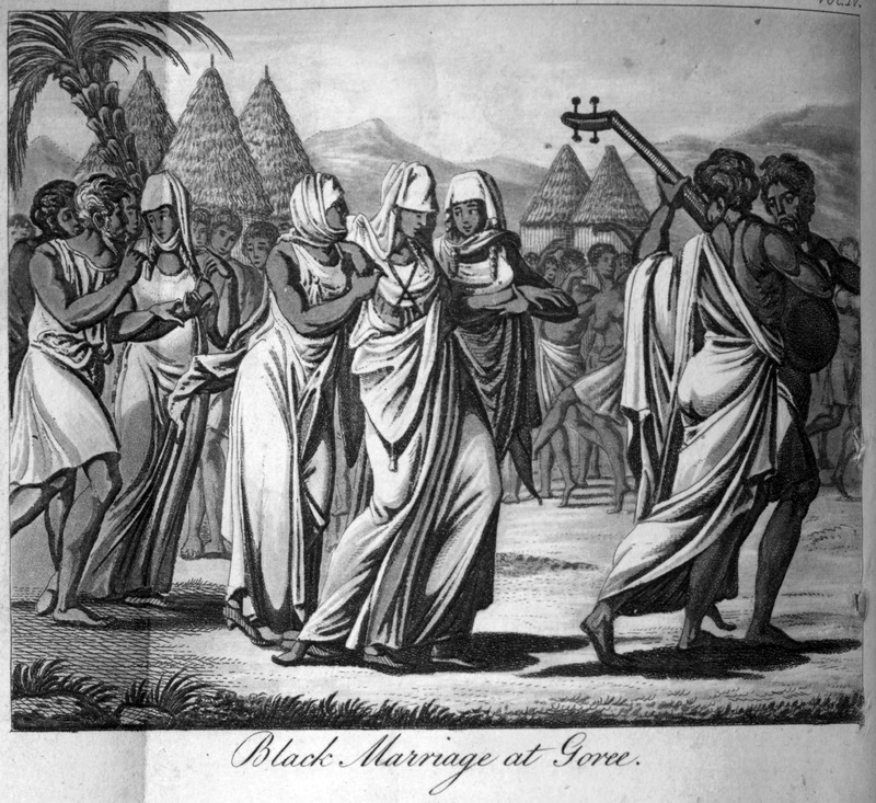 """This image depicts conical roofed houses and musical instruments on Gorée in the Senegambia region. According to Durand, """"a girl is frequently betrothed to a man as soon as she is born. . . On the day agreed on for the marriage, the bridegroom places on the road which the bride has to pass, several of his people at different distances, with brandy and other refreshments; for if these articles are not furnished in abundance, the conductors of the bride will not advance a step further, though they may have got three parts of the journey. On approaching the town, they stop, and are joined by friends of the bridegroom, who testify their joy by shouting, drinking, and letting off their pieces,"""" i.e., firing guns (p. 104-105). This image is one of several fanciful engravings created by the publisher for this volume and not based on an eye-witness sketch. Jean-Baptiste-Léonard Durand (1742-1812) was a French director for the Compagnie du Sénégal in 1785 and 1786. The first edition in French does not contain any images."""