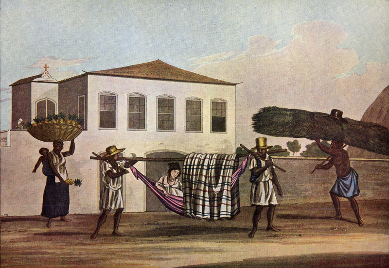 Caption, called the Rede this sort of hammock, the author writes, is usually made of cotton net, dyed of various colours and fringed, in which females, a little above the lower classes, are carried about by their slaves; it is furnished with a pillow to lean upon, and across the bamboo, from which it is suspended, is thrown a covering or curtain fantastically striped. When the lady wishes to stop, the carriers plant their sticks in the ground and support the ends of the bamboo on the iron fork fixed at the end of each for that purpose, until their mistress chooses to proceed. On the right, a male slave is carrying a load of Capim or Guinea Grass while on the left, the woman carrying her child is selling pineapples (pp. 202-203). The foreground figures in Chamberlain's book were copied from three separate water-colors drawn earlier by Joaquim Candido Guillobel. Born in Portugual in 1787, Guillobel came to Brazil in 1808, and from 1812 started drawing and painting small pictures on cards of everyday scenes in Rio de Janeiro. For biographical details on Guillobel, who died in 1859, and reproductions of about 60 of his original drawings in color (including the ones shown here), see Joaquim Candido Guillobel, Usos e Costumes do Rio de Janeiro nas figurinhas de Guillobel [1978]. The text of this volume is given in both Portuguese and English; the author of the biographical notes who is, presumably the compiler of the volume, is not given in the Library of Congress copy that was consulted. (See this website, Chamberlain for related drawings.)
