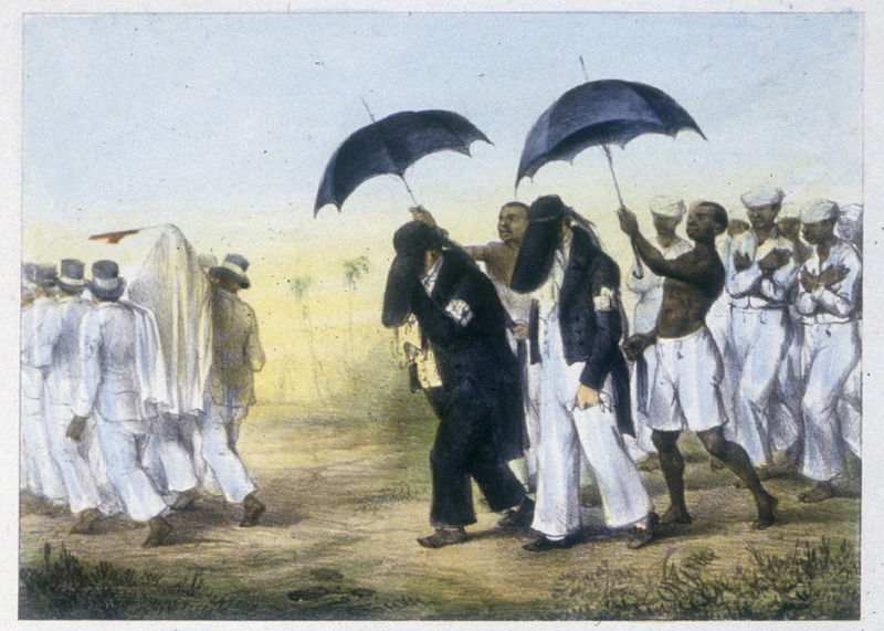 """""""Funeral Convoy of a Quality Person, Preceded and Followed by Negro Slaves"""" (caption translation). The funeral procession for an important/wealthy European involved slaves, who hold umbrellas over the chief mourners. """"When a rich person dies,"""" Benoit writes, """"his coffin is carried by a dozen blacks. Family and friends follow, dressed in black. Their heads are covered with a sort of hat that entirely hides their face; a black veil is attached to the coffin and the slaves who walk behind each one carry a large green umbrella over the heads of the persons who accompany the coffin"""" (p. 23). Benoit (1782-1854), a Belgian artist, visited Suriname around 1831 and apparently stayed for several months. The 100 lithographs in his book (hand colored in the John Carter Brown copy), accompanied by textual descriptions of varying detail, are derived from drawings he made during his visit, which included time in Paramaribo, the capital, as well as trips into the interior visiting Maroons and Amerindians. Forty of his lithographs, with our translations from the French text, are shown on this website."""
