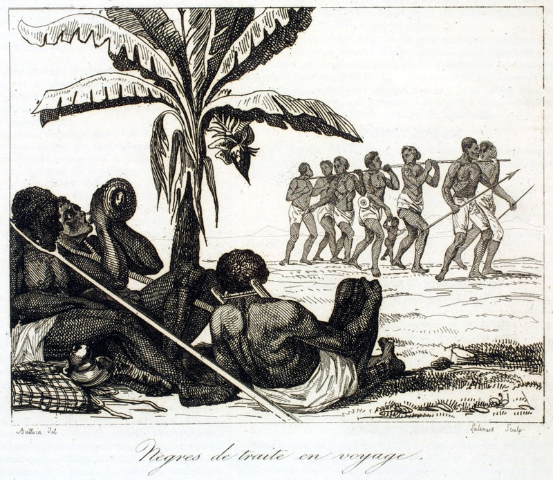 Caption:Negres de traite en voyage (Enslaved Negroes in Travel). This is supposed to depict a scene in the Senegal region showing enslaved Africans being taken to the coast for sale; note, the forked logs or tree branches around their necks, a common way in which slaves were linked in coffles.