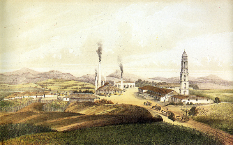 """""""Sugar Plantation Manaca"""" (caption translation). This image shows a central area or yard of a plantation with a steam factory, various outbuildings, and church or chapel. The accompanying text gives information on location, ownership, technical features of sugar production and similar data, and notes that as on other small and medium-sized plantations the enslaved are not housed in barracks but in individual houses. Their thatched houses are shown on the left. Justo German Cantero (1815-1871) was born in Trinidad, Cuba. The image shown here is from the 1984 reprint which only reproduces, on a smaller scale, 13 of the 28 colored lithographs found in the original 1857 edition. Images in the latter can be viewed on the British Library website, Images Online."""
