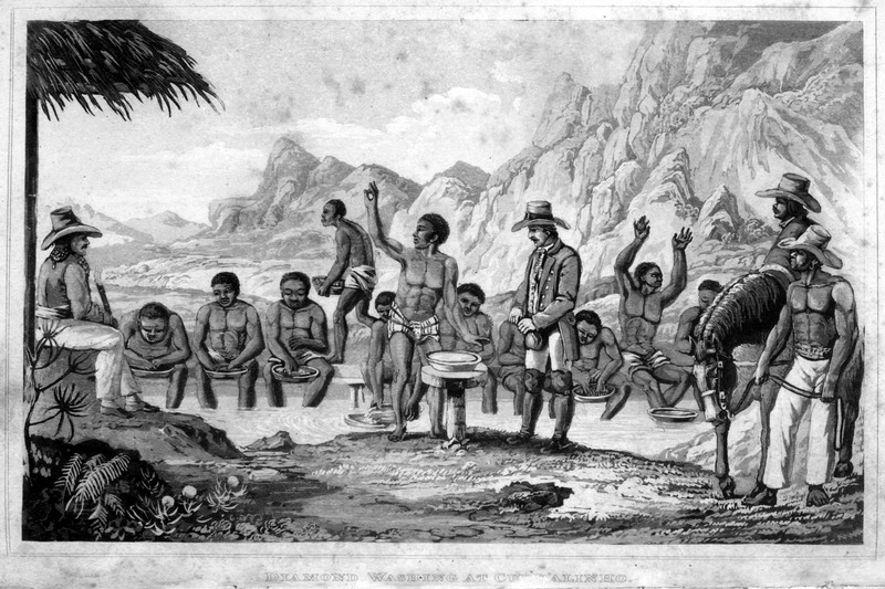 Caption, Diamond washing at Curralinho. This plate is described on p. ix: The negroes looking for diamonds, sit in a row on a bench in a shallow pond. Some are busy washing, in wooden bowls . . . the gravel taken from the bed of the river; others hold up their arms, with their fingers spread, to show that they have found nothing in the bowls, which are swimming empty in the water, or they are fetching fresh gravel from the heap near them. Before the pond is a bowl with clean water, in which a negro is going to put the diamond he has just found, after holding it up between his fingers to show it. To the right and left, on a seat a little raised, and under a kind of parasol, is an overseer to watch the negroes at their work. The director, who is just arrived, puts the diamonds that have been found into a bag. The same image appears in the Atlas of the original German edition: Johann Baptist von Spix, Reise in Brasilien (Munchen, 1831), plate 9.